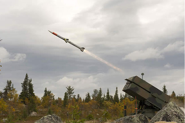 An Amraam AIM-120C7 missile is fired from<br>a Nasams canister launcher.