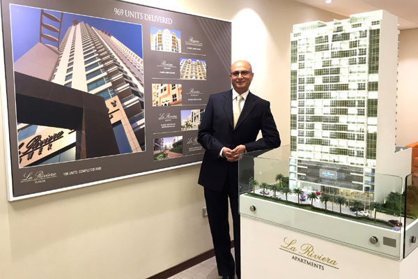 Razzak showscases the model of the deluxe apartment block