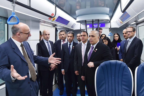 The RTA delegation takes a tour of the new metro trains.
