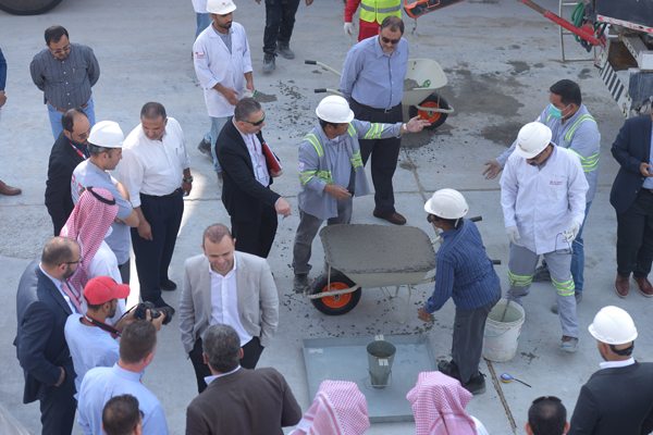 Officials at the live batch plant trial in Al Ahsa.