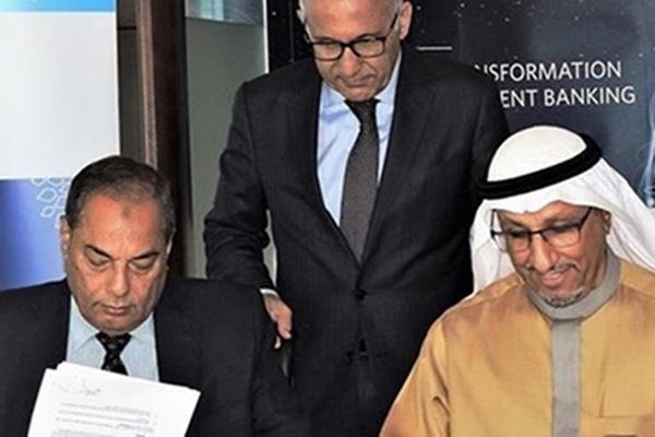 Saedan Group and Ibdar Bank officials at the signing ceremony.