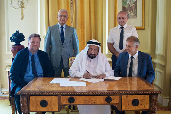 Dr Sheikh Sultan signing the contract in London.