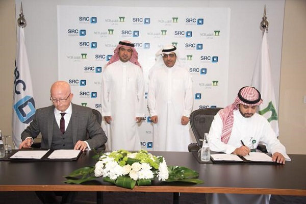 Officials signing the deal in the presence of Al Hugail.