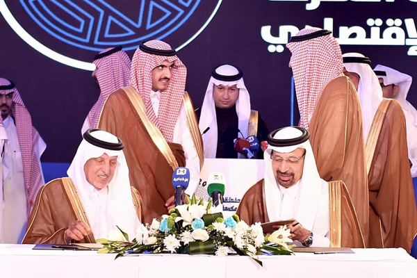 Al Falih and Prince Khalid at the signing ceremony.