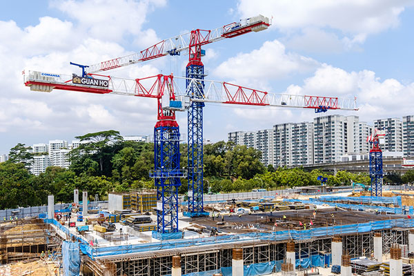 Industrial construction cranes in the Singapore city